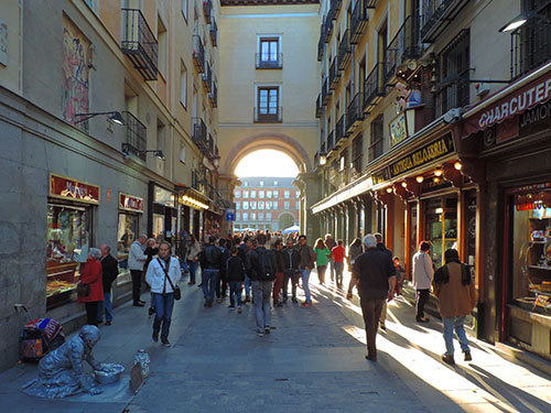 people on an Old World street in Madrid, one of my hidden gems in Europe