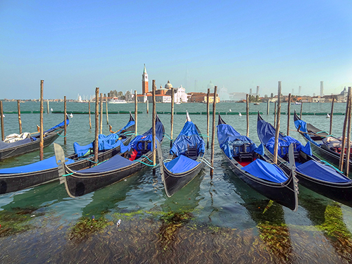 gondolas in a canal in Venice, one of my hidden gems