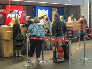 a car-rental desk in an airport - rental car insurance