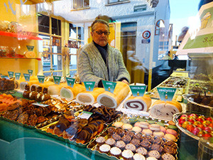 man in a candy store Bruges, Belgium