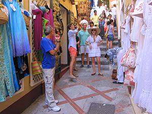 people walking by shops