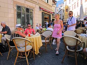 people at cafe tables on the Amalfi Coast