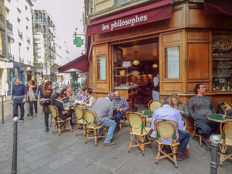 people at a cafe in the Marais, one of the top 10 places in Paris