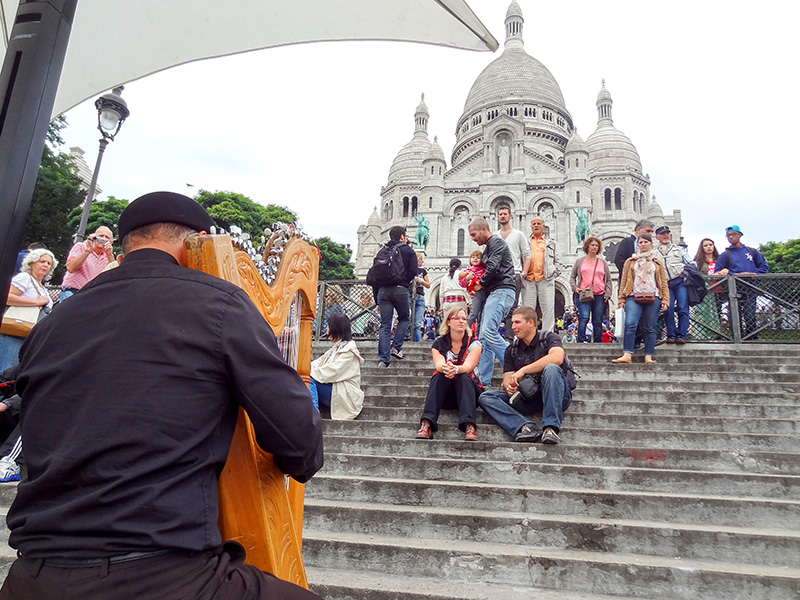 a harpist in front of Sacre-Coeur, one of the top 10 places in Paris