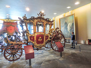 an old carriage in a castle, one of the places in Mexico City to visit