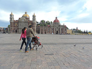 people walking in front of a cathedral in Mexico City