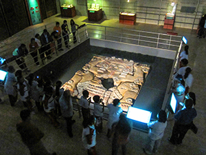 a museum exhibit surrounded by people