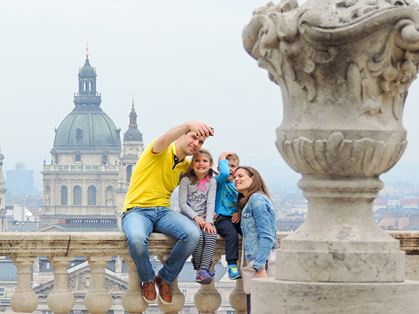 a family taking a selfie, one of the things to do in Budapest
