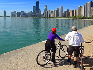 people on bicycles looking at a skylinea museum exhibit in Chicago