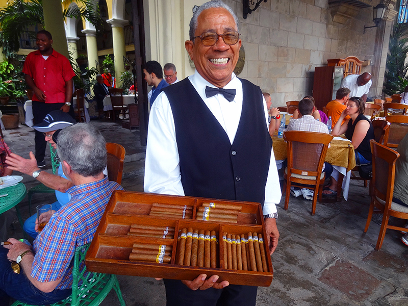 waiter with a box of cigars