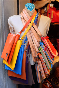 leather bags on a rack in Florence