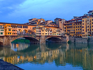 a bridge over a river in Florence