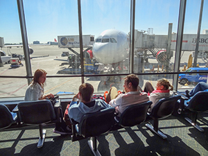 group looking at plane in air-travel