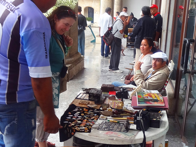 visiting a sidewalk flea market, , one of the things to do in Havana