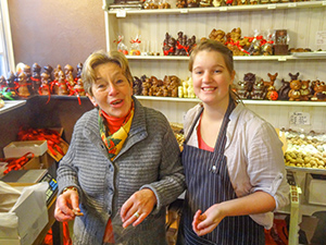 two women in a chocolate shop, one of the top places to visit in Belgium
