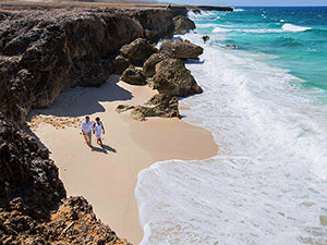 couple walking on a Caribbean beach