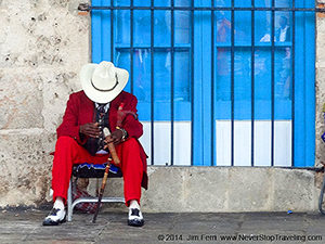 man in a red suit in the Caribbean