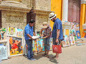 sidewalk art vendor in Cartagena