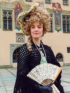 a woman in period costume in Bavaria, seen on a day trip from Munich