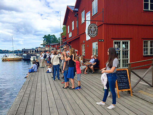 people at a ferry dock in Sweden
