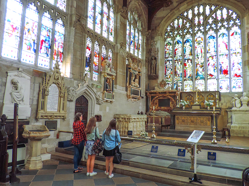 people in an old church on day trips from London