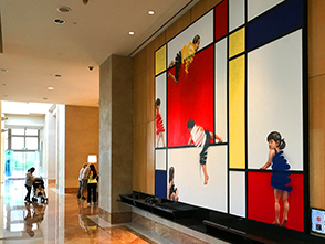 a large painting in a hotel lobby