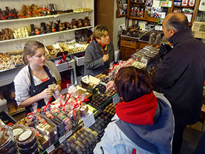 people in a chocolate shop in Bruges