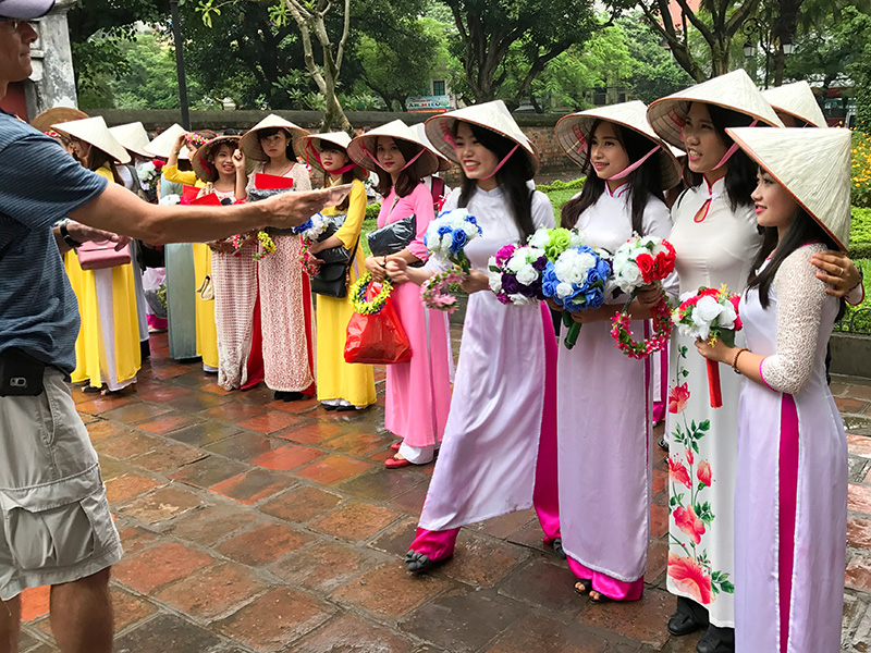 young women in colorful dresses seen during 2 days in Hanoi Vietnam