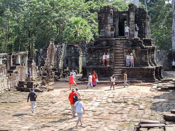 people at an old ruin in Angkor Thom, Cambodia