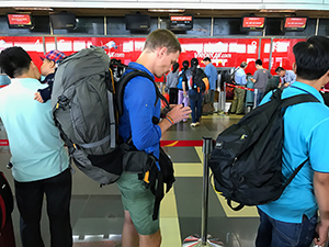 people in an airport - save airfare