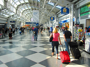 people in an airline terminal - how to find cheap flights anywhere