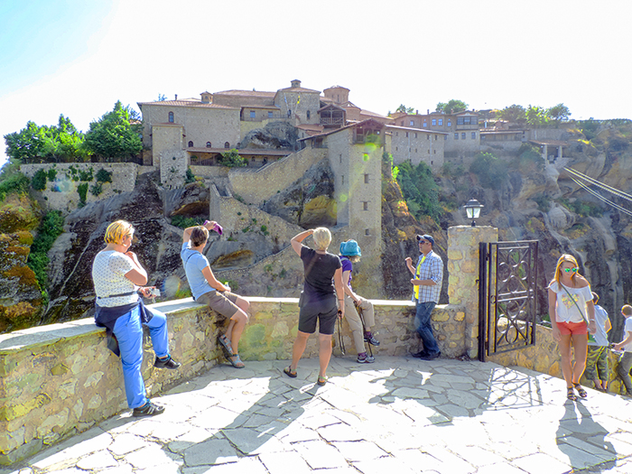 people looking at an ancient building