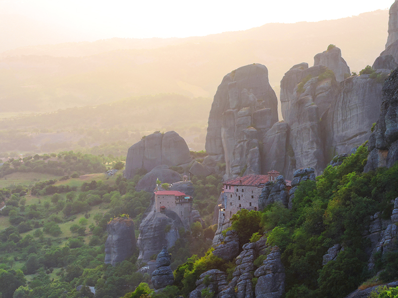 Monasteries of meteora on a cliff at sunsel