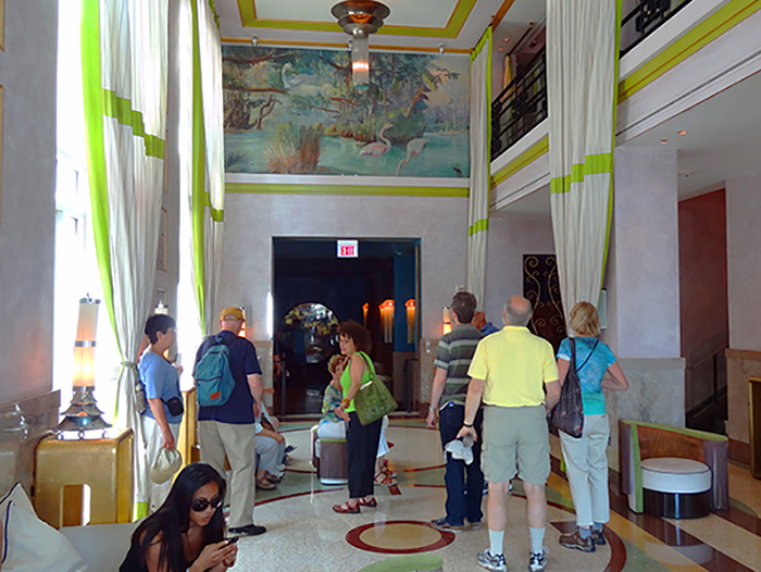 people standing in a hotel loby in South Beach Miami