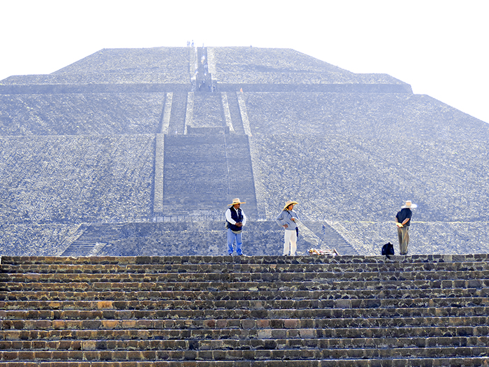 people near an ancient pyramid