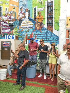 joining people at a party brightly painted wall in San Juan - one of the things to do in Puerto Rico San Juan