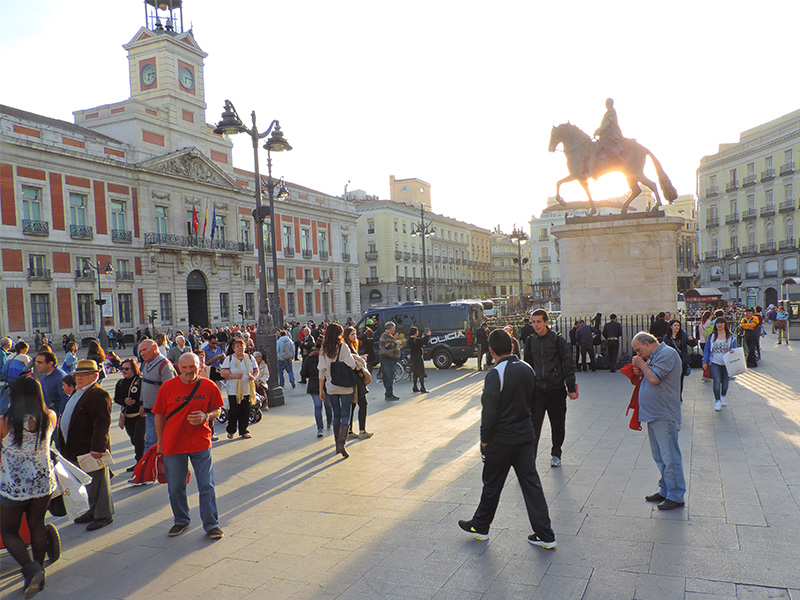 people walking in a city square