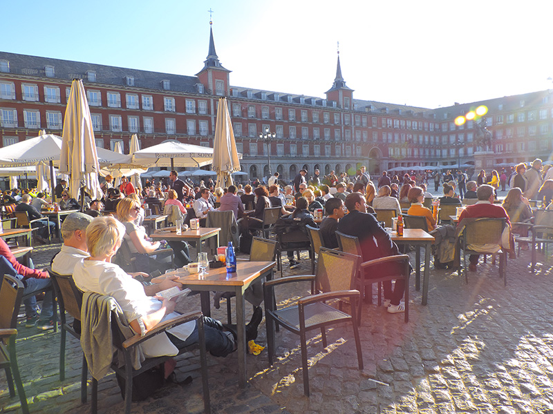 people in cafes in the Plaza Mayor, one of Madrid's top places