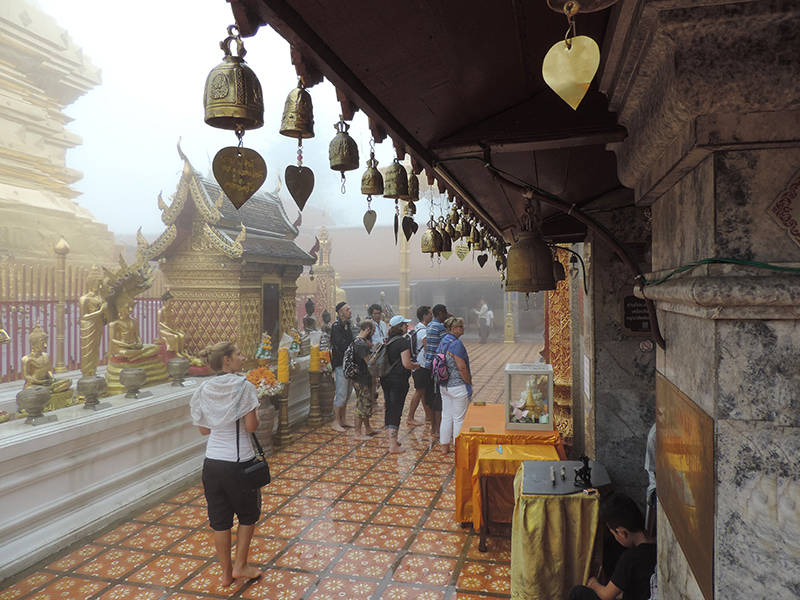 people walking in a temple in Chiang Mai