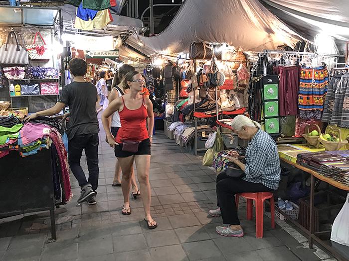 women walking throgh a bazaar in Chiang Mai