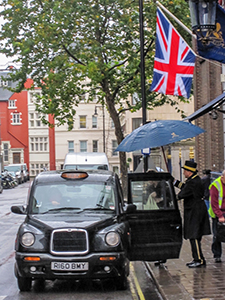 a British flag over a cab - how to save on hotels