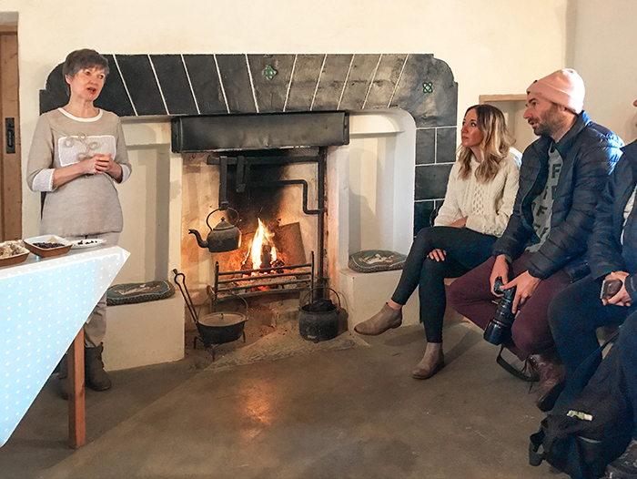 people by an old fireplace in Galway
