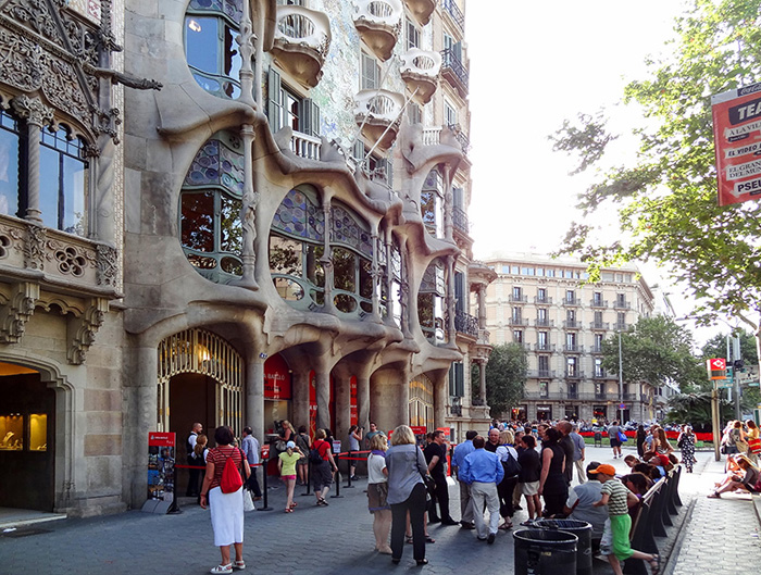 people outside an ornate building