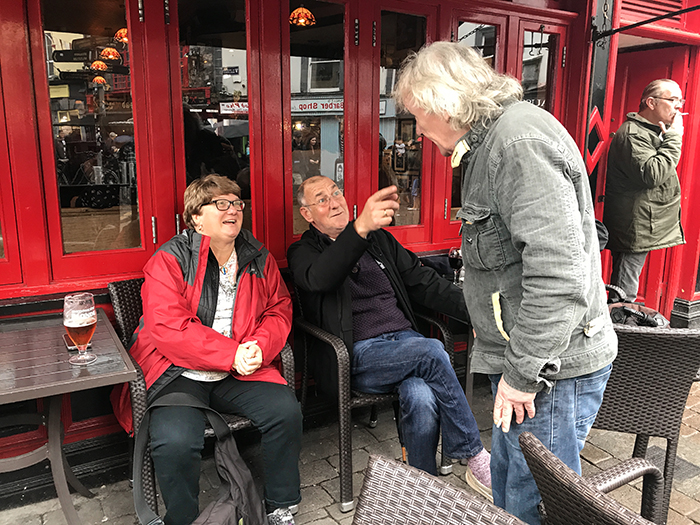 people talking in a pub in Galway