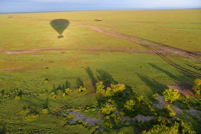 shadow of a hot-air balloon over Maasai Mara