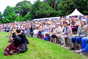 a crowd seated at a festival