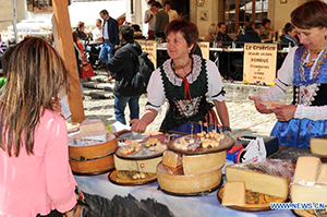 woman in a costume selling cheese