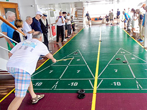 people playing shuffleboard on a Pacific cruise