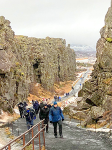 people on a path in a canyon on an Iceland tour
