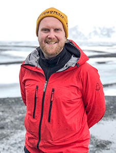 a tour guide in a red jacket